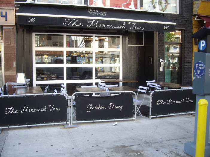 & Glass Garage Doors for your New York City Restaurant or Storefront