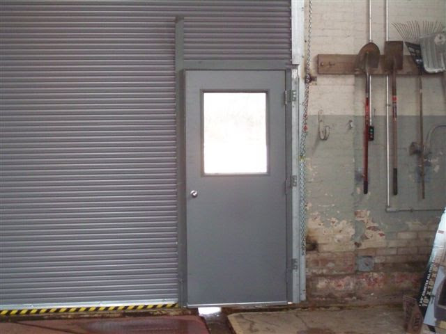 Roll Down Door with Man Door; Closed Roll Down with Pass Door