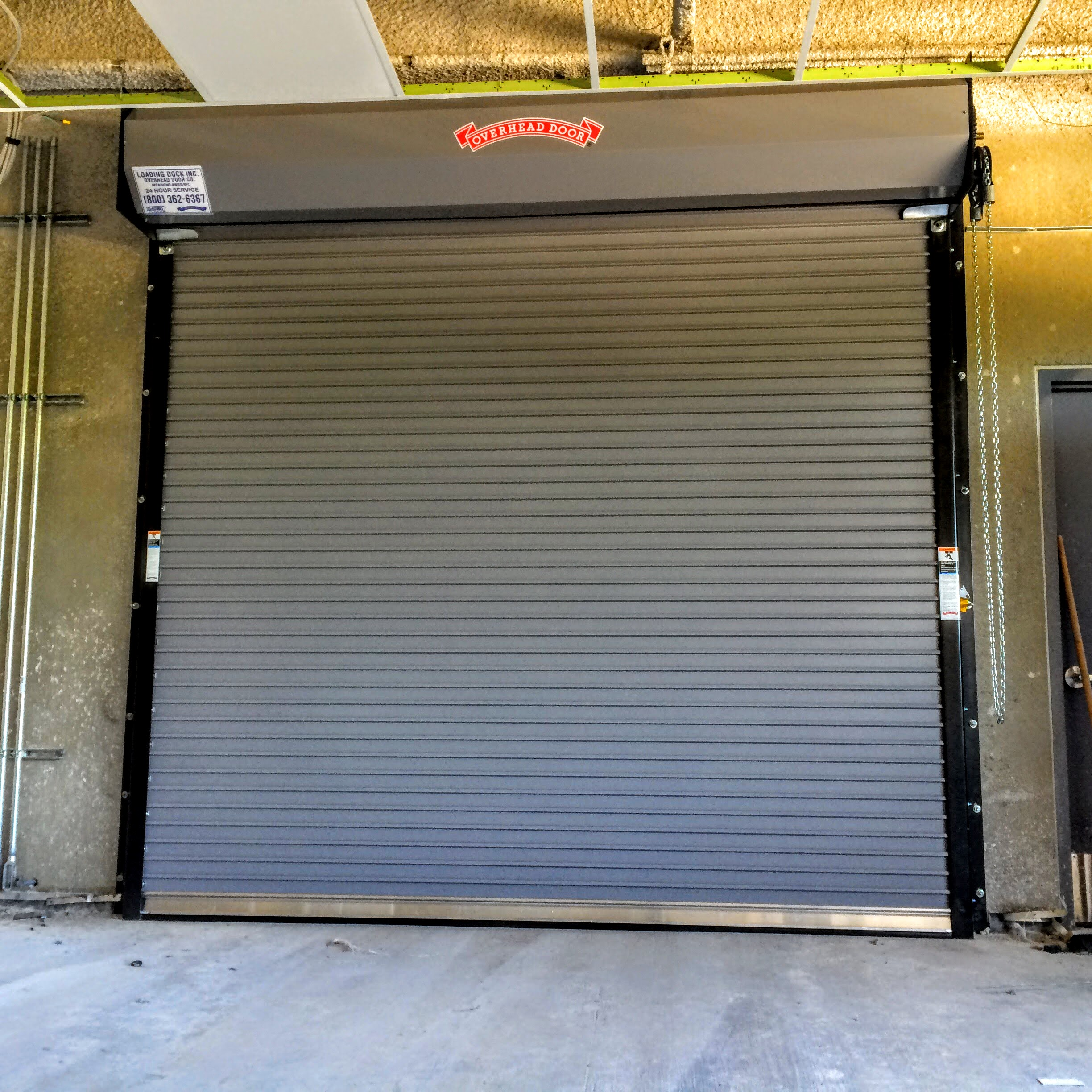 Non-insulated roll down gate with weatherized seals and chain hoist & Rolling Steel Doors