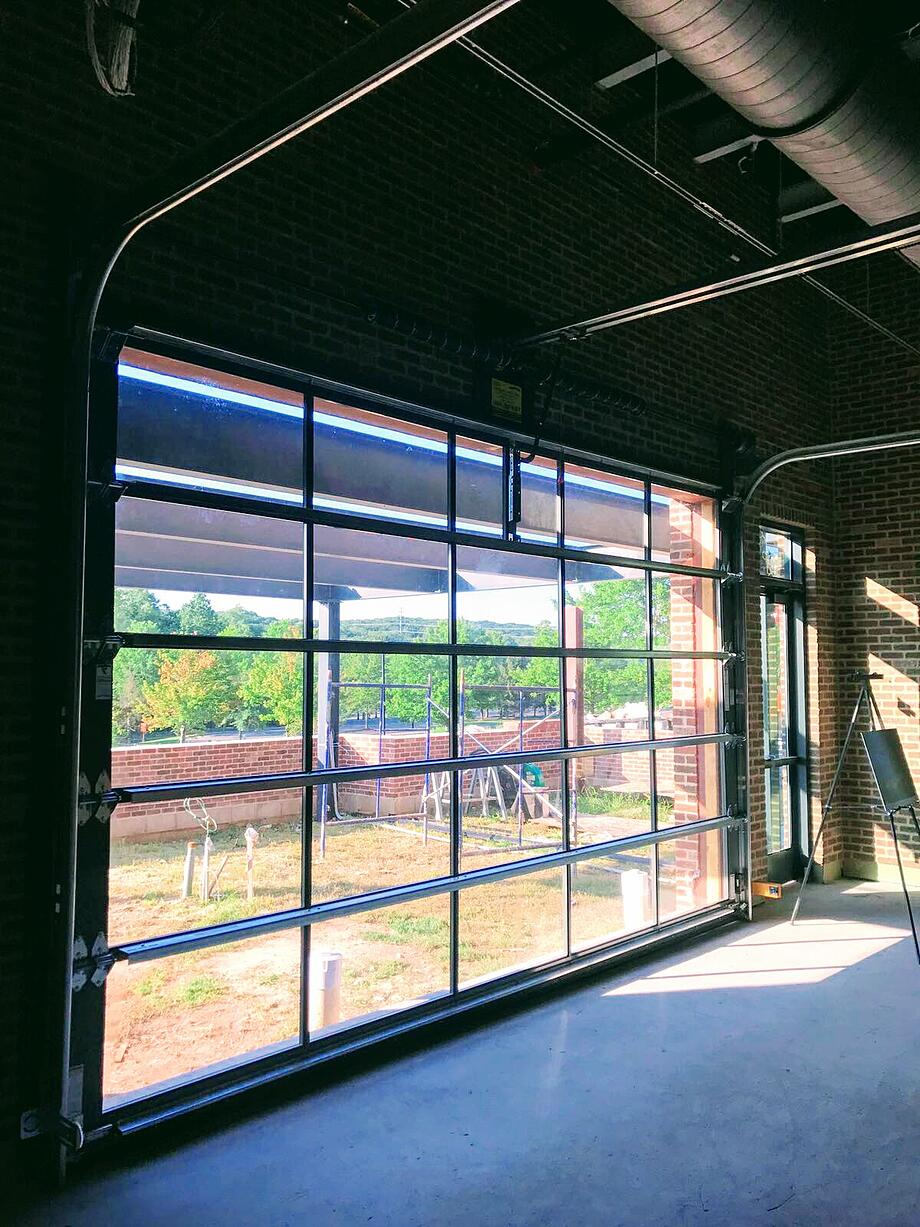 Aluminum glass garage overhead sectional roller doors in for Overhead shed doors