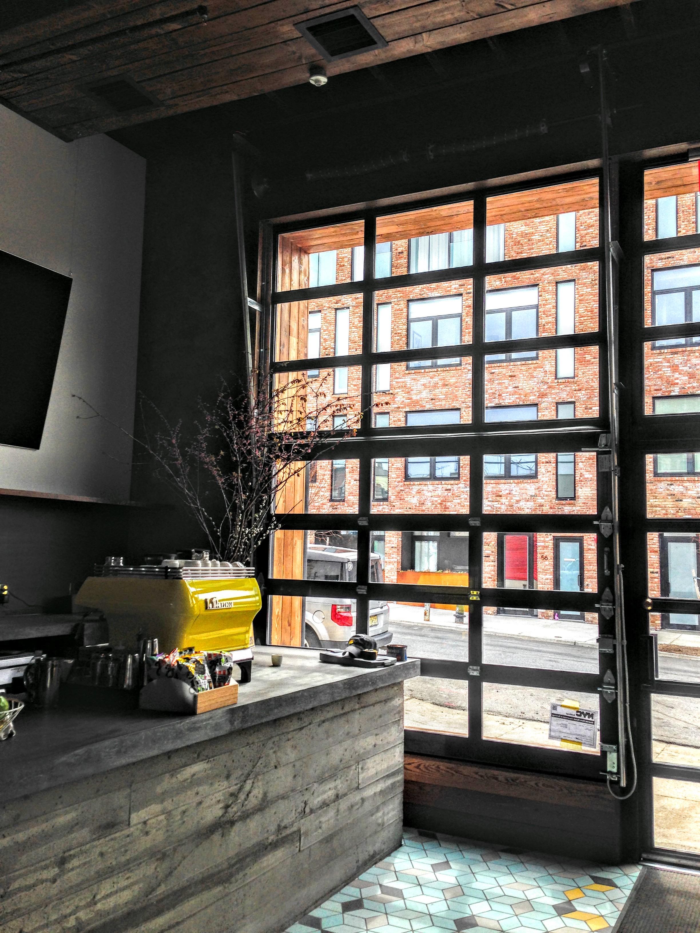 Den_Brooklyn_interior_view_metal_glass_garage_door_brooklyn.jpg