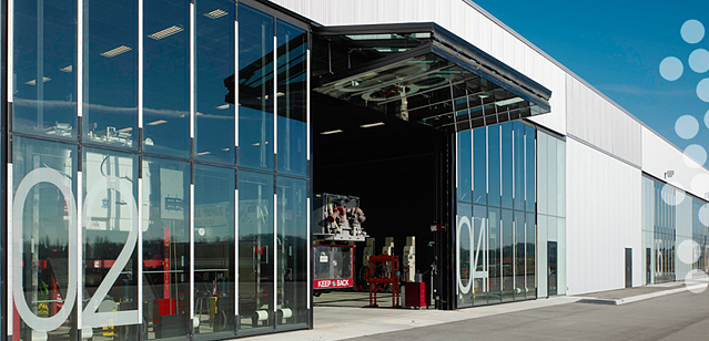 Designer_Canopy-type_Bifold_Garage_Doors_New_Market_Operations_HQ.png