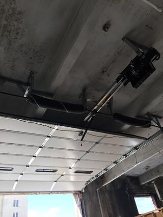 Low_Head_Room_Springs_to_Rear_System_for_Sectional_Overhead_Garage_Door.jpg