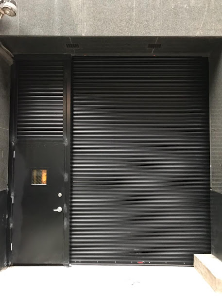 Sectional Amp Rolling Doors With Passthrough Door Photo