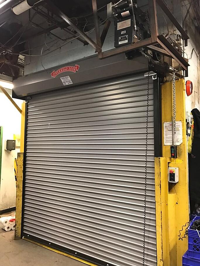 Rolling Door Gate Red Zone for Install and Service; rolling door service picture; gray rolling doors.