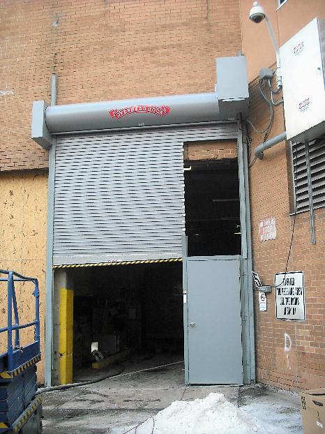 Sectional Door with Pass-Through Door; Gray Sectional Door with Pass-Through Door; Sectional Door service-1
