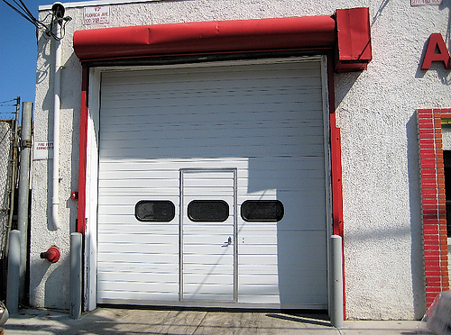 Sectional Door with Pass-Through Door; White Sectional Door with Pass-Through Door; view from the outside-1