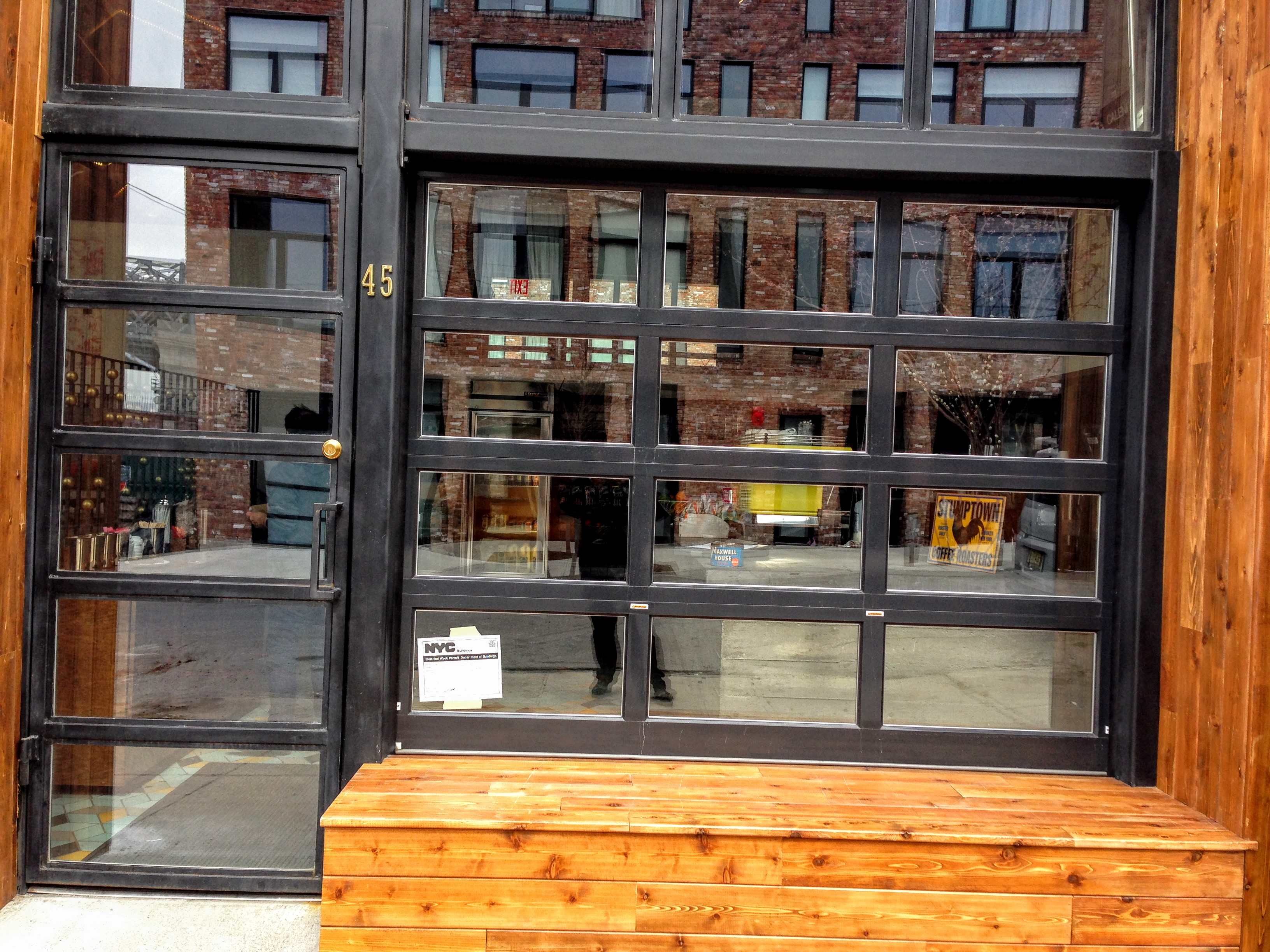 black metal and glass garage door for freehold coffee in