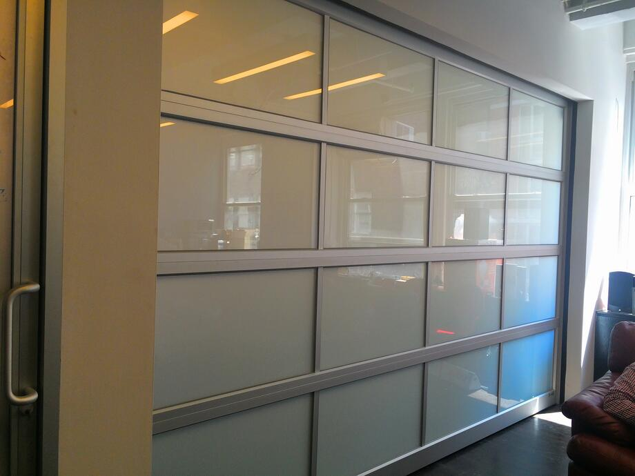 frosted-glazing-aluminum-metal-conference-room-overhead-garage-door.jpg
