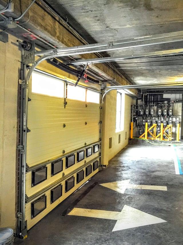 Flood vents for parking garage doors for Garage smart trocadero