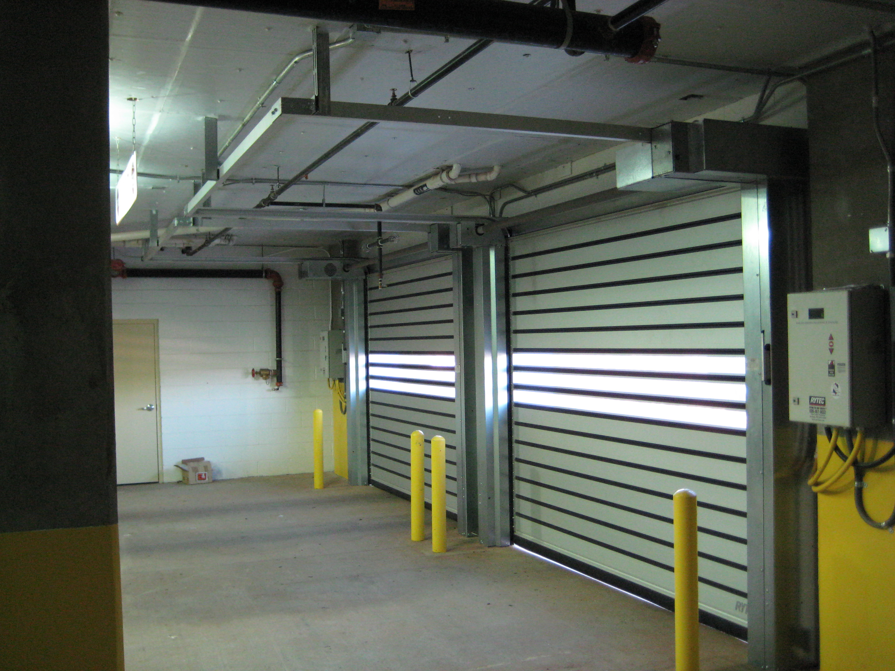 Low_headroom_clearance_garage_door_rolling_gate_NJ_NYC_high_speed_rytec  Rytec_Low_Head_Room_Coiling_Door
