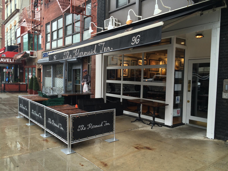 nyc-glass-metal-roller-garage-door-restaurant.jpg