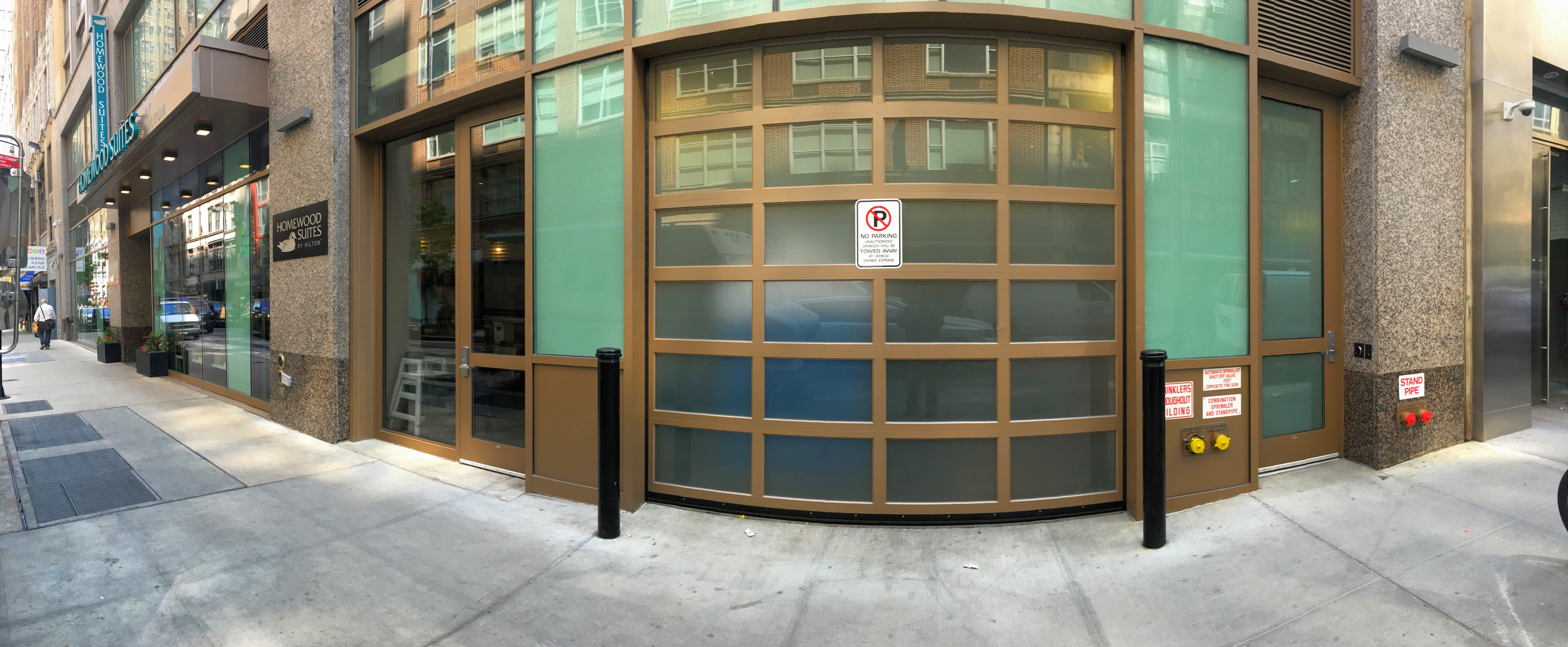 Homewood Suites hired us to install a beautiful and stylish aluminum glass garage door for their storefront retail loading dock.