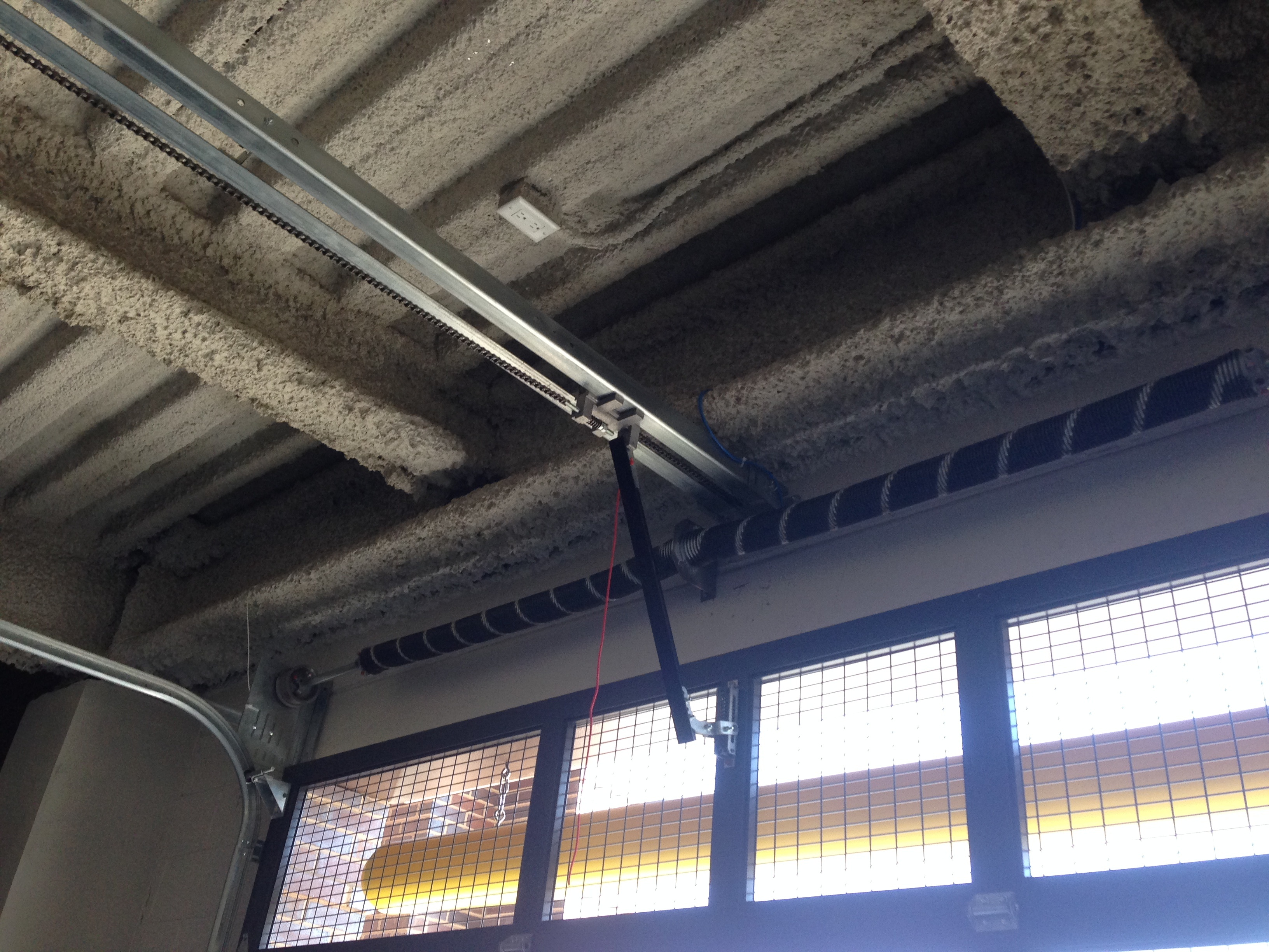 wire-mesh-perforated-overhead-garage-rollup-sectional-track-aluminum-door.jpg