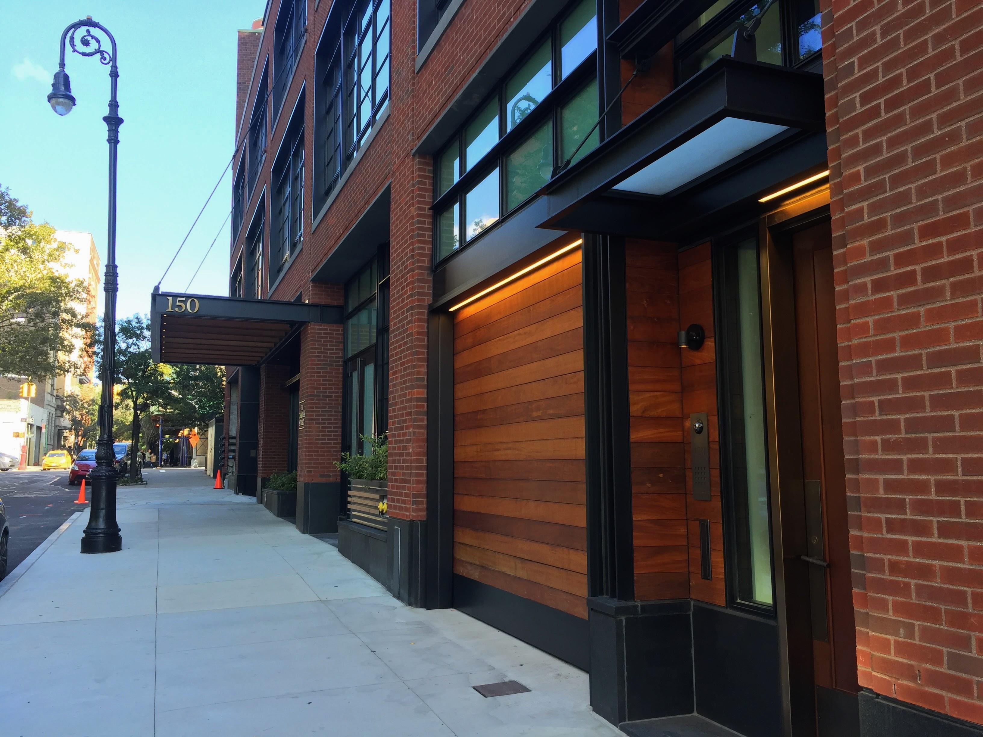 Wood_overhead_garage_roll_up_doors_manhattan. Wood Garage Doors ...