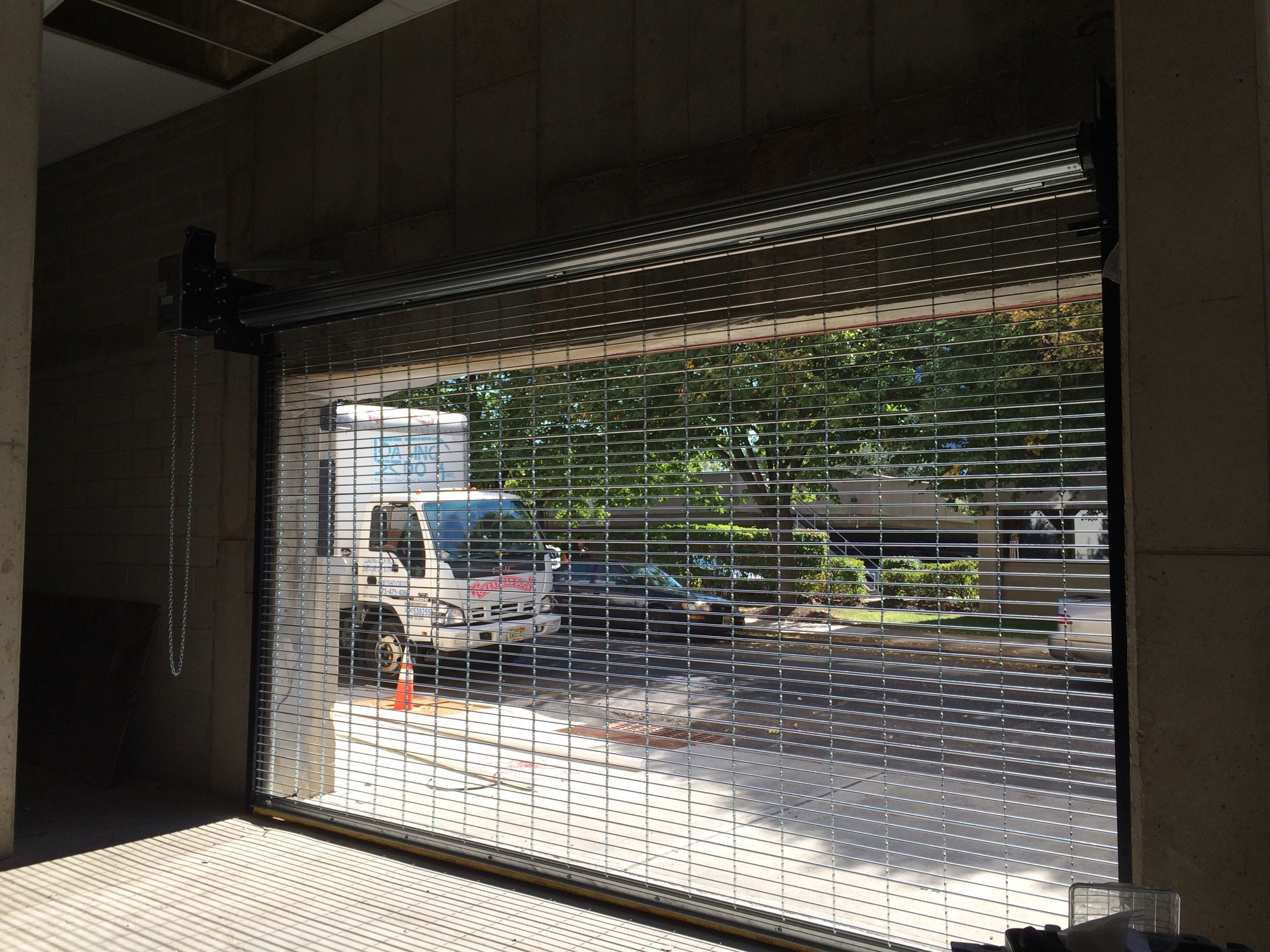 Motorized metal roll up shutters and rapid overhead roll for Roll up screen door for garage